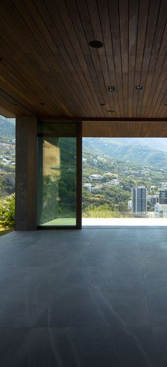 A Weiland Liftslide door opens this pavillion to a mountain view. | Big Views | weilandslidingdoors.com