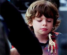 this gif (and this show) is important. Kennex, the tiny giraffe and Victor. Almost Human.