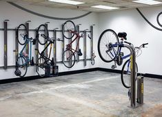 Top 70 Best Bike Storage Ideas - Bicycle Organization Designs From overhead to on the wall and beyond, discover the top 70 best bike storage ideas. Explore unique and creative bicycle organization designs.