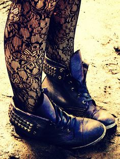 Lace tights paired with boots.