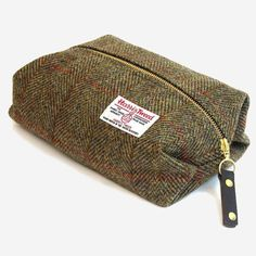 Part of our Made in Britain range, this fine quality wash bag is handmade from Harris Tweed. Harris Tweed is the only fabric in the world governed by its own Act of Parliament. Garra, Vanity Case, Tweed Ride, Fancy, Harris Tweed, Wash Bags, Toiletry Bag, Stocking Stuffers, Messenger Bag