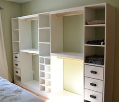 This is awsome& we already have 2 big entertainment centers we dismatled to repurpouse as shelfing, i bet we could use em at least for the cubbys...build to fit along the wall either in our bedroom or in spare room since our closets are almost 2small for even childrens clothing..im so excited Ana White | Build a Master Closet System | Free and Easy DIY Project and Furniture Plans