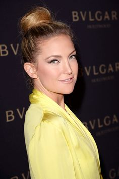Kate Hudson.  How To:  Instead of wrapping all of your in one movement, pull strands into a high pony(use a hair colored band) then create a bun but leave one large section out of the mix.  Then, wrap that section tightly around the entire bun and pin in place.  Pull out super fine pieces from the bun and around your face and spray a mist of texturizing spray all over, for a casual, a slightly undone effect.