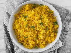 This savory Yellow Jasmine Rice combines warm and fragrant Indian spices and chicken broth to make the most flavorful rice you've ever tasted!