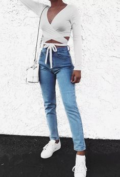 cb2f38d02d8a White wrap crop top with washed jeans. Trendy and cute outfit with white  shoes and white bag.