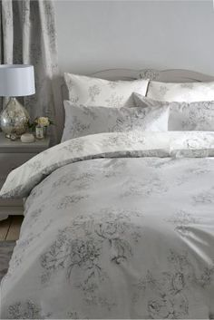 This grey bedding is the perfect way to update your bedroom and make your home decor feel a little bit more feminine.