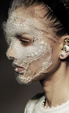 FASHION: Givenchy goes to extremes, from pearlescence to pearls
