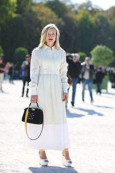 "The Best ""What IS She Wearing?"" Looks From Paris #refinery29  http://www.refinery29.com/2015/10/95202/paris-fashion-week-spring-2016-street-style-pictures#slide-47  The top-handle bag is the must-have of the season...."