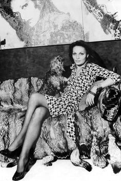 Diane von Furstenberg in her own wrap dress. Now I want to get one