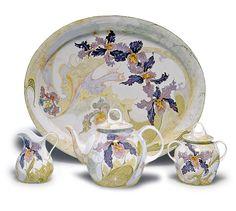 Haagsche Plateelbakkerij Rozenburg. Eggshell porcelain 'Orchids' teaset, 1904/05. Decorated by Samuel Schellink. Four pieces. Teapot, H. 12.8 cm; creamer, H. 8.4 cm; sugar bowl, H. 10.5 cm; tray, 34 x 27.4 cm.  SOLD 4,000 EUR, 2013