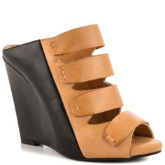 Marah - Jessica Simpson. Just got my pair, and they are SO comfortable. Padded to the hilt inside <3 They run a bit large, so go half size smaller - any extra room at the back will make them look clunky, but if your foot fills them in completely they look great!