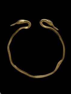 Oxus Treasure - Gold penannular bracelet: with duck's head terminals; plain hoop with triangular transverse section. Achaemenid - 5thC BC-4thC BC