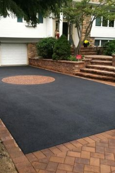 All about asphalt access roads and the best time of year to install themA guide to asphalt accessAsphalt driveway. So stylish! So stylish! Asphalt Driveway, Driveway Paving, Driveway Design, Driveway Entrance, Circular Driveway, Driveway Landscaping, Driveway Ideas, Patio, Backyard
