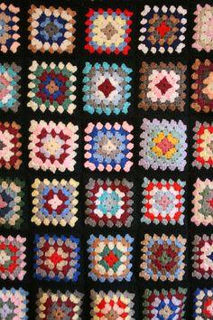 Multi-colored granny square blanket