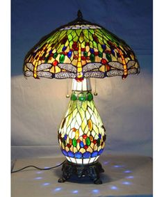 @Overstock - This elegant Yellow Dragonfly Table Lamp has been handcrafted using methods first developed by Louis Comfort Tiffany. Shade contains hand-cut pieces of stained glass wrapped in fine ...http://www.overstock.com/Home-Garden/Tiffany-style-Yellow-Dragonfly-Lighted-base-Table-Lamp/1582006/product.html?CID=214117 $130.99