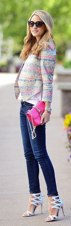 Patterned blazer, a white t-shirt, skinny jeans, white heels, and a studded hot pink clutch.
