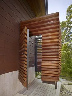 outdoor shower. A second room next to this, with slatted roof, for shaded wetsuit and surfboard storage.