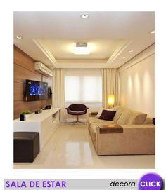 Reparem o trabalho de gesso que foi feito no teto e a distribuição de iluminação proporcional ao ambiente. O tipo de lâmpada influência muito em um ambiente.