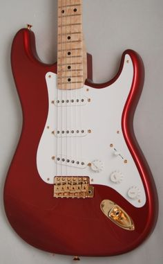 Fender Custom Shop '56 Stratocaster NOS (Candy Apple Red, Birdseye Maple Neck, Gold Hardware)     These guitars originated from a cancelled custom order straight from the USA. They proved so popular for us we can't stop ordering them. Hank Marvin style spec in a beautiful candy apple red finish. £2149 #fender #vintage #guitar #stratocaster #candy #red