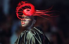 A model presents a creation by milliner Philip Treacy as part of the Haute Couture Fall/Winter 2001/2002 collections shows on July 10, 2001 in Paris France.