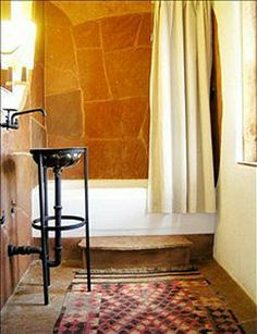 Charming bath in Taos adobe- cute sink and faucet