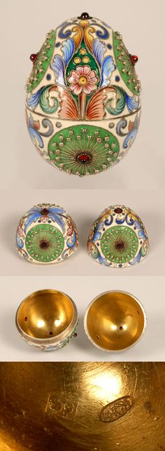 A Russian gemset, gilded silver and shaded cloisonne enamel egg by Feodor Ruckert, Moscow, circa 1896-1908, decorated with large green circular reserves agains a cream ground, highlighted with shaded foliage, the green reserves mounted with cabochon garnets.