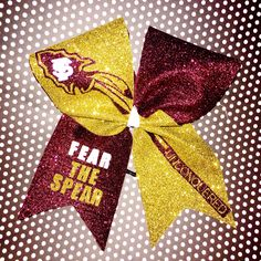 FSU Cheer Bow. Fear the Spear Unconquered glittery Florida State Seminoles Cheer Bow. Your cheerleader will shine as bright as her favorite team wearing this beautiful bow. Go 'Noles!