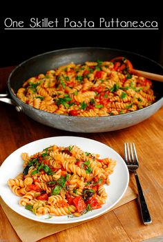 Pasta Puttanesca – pasta tossed in a light tomato sauce laced with garlic, kalamata olives, capers, and parsley – is made in just one skillet! | iowagirleats.com