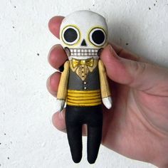 Tiny Day of the Dead Skeleton Doll Ornament-- Hand Painted Original Folk Art Sculpture-- Made to Order within a Week. $55.00, via Etsy.
