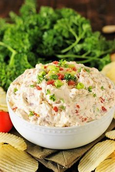 This easy little BLT Dip is loaded with great bacon flavor that's beautifully complimented by sun dried tomatoes and green onion. It's perfect for dipping those good ol' potato chips!