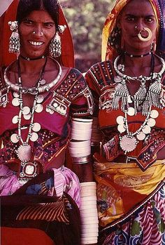 "Rajasthani Women, India.The wealth of the family carried by the women, the walking ""safety deposit!"" The white bangles are made of bone or PVC today, as the elephant tusk is now protected."