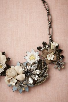 Cultivar Necklace ~ A sweeping arrangement of exquisite vintage silk flowers interwoven with Swarovski crystal baubles.