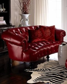 red leather tufted sofa