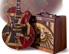 "Gretsch Custom Shop. (Wow, first time I've seen ""The Red Barron"" WITH the amp in the pic.) Glad to get this. This axe, alone, has been one of my fav guitar pins. ~Rooster"