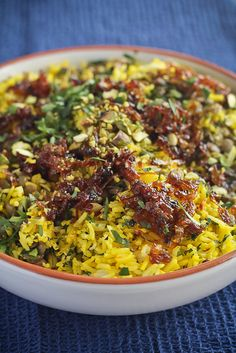 Moudardara - Lebanese rice & lentil dish topped with caramelised onions & saffron #recipe by @demuths Vegetarian Cookery School.