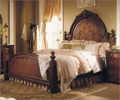 A gorgeous bed - I love the walnut, mahogany, rosewood, elegantly embellished work in Victorian wood furniture pieces.