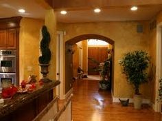 Tuscan style – characterized by a pronounced rustic, simplistic finishes with elegant iron accents, terra-cotta tiles and textured walls with murals, detailed and elegant (trompe l'oeil). Tuscany Homes, Tuscany Italy, Tuscany Decor, Tuscan Colors, World Decor, Tuscan Decorating, Decorating Ideas, Tuscan Style, Interior Exterior