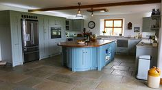 Farm House Kitchen with Tumbled Limestone Flag floor, Cabinets by Eastburns Country Furniture