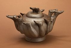 "satoko barash Tea Party Inside a Teapot, high fired stoneware, 7"" x 10"" x 6"""
