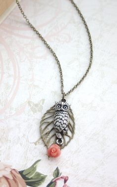 An Owl and Leaf Necklace Coral Stone Flower.. This would be a perfect gift for me hootie girlfriends! <3