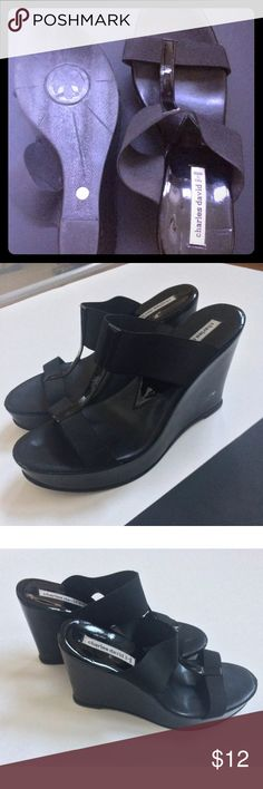 Charles David Black Wedge Heels Charles David brand back strapless wedges in a black on black color. Size 8. Heel is 4.5 in tall. The straps are stretchy material to better fit your foot. Made in Italy. There is some minor damage to these shoes as described in the condition, please refer to that before purchasing :) Charles David Shoes Wedges