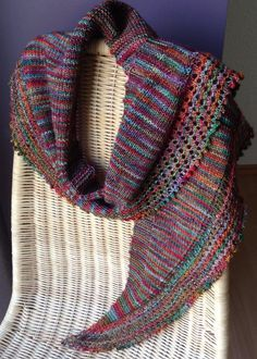 Free Knitting Pattern for Cinnamon Grace One Skein Shawl - Easy crescent shawlette with stockinette body and eyelet border designed for 400 – 440 yards (366 – 402 m) of sport yarn though I'm sure you could adapt for other weights and sizes. Designed by Katie Harris. Pictured project by Wondermoehre who used less than a skein of sock yarn instead. Available in English and Hungarian. Looks great in variegated yarn!