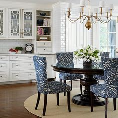 Via Traditional Home. Beautiful fabric on dining chairs make the chairs kids friendly and interesting at the same time.