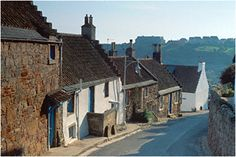 Shoregate Crail Fife Scotland - a steep hill lined with tiny houses lead up from the harbour into the village.