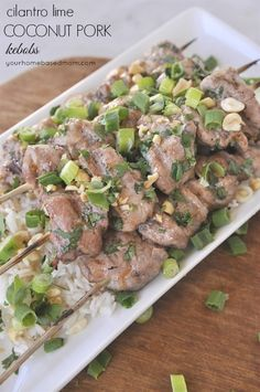 Cilantro Lime Coconut Pork Kebabs Recipe -  These are delicious! Cooked on the grill and then garnished with cilantro, peanuts and green onions.