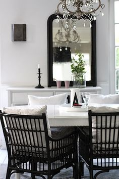 Black glossy rattan chairs More