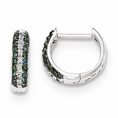 These small 14k white gold huggie hinged hoops with blue and white diamonds will stylishly grace your face, adding sophistication to any occasion.