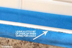 HOW TO caulk like a professional - Leave slight gap between tape and desired caulk line.  Wait about 10 minutes then peel tape.
