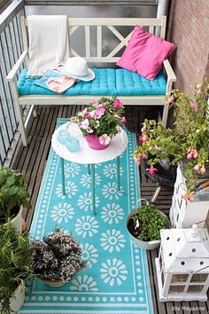 decorating for the apt balcony. small outdoor rug and a cozy place to sit