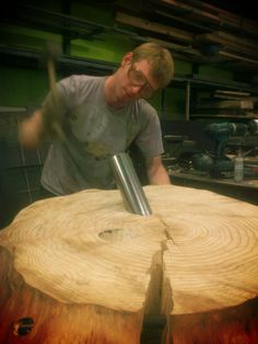Lane working out his live edge side table with steel pipe legs.